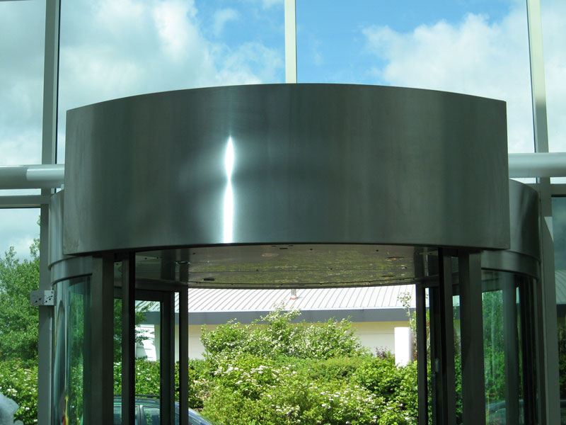 Revolving door air curtain in stainless steel